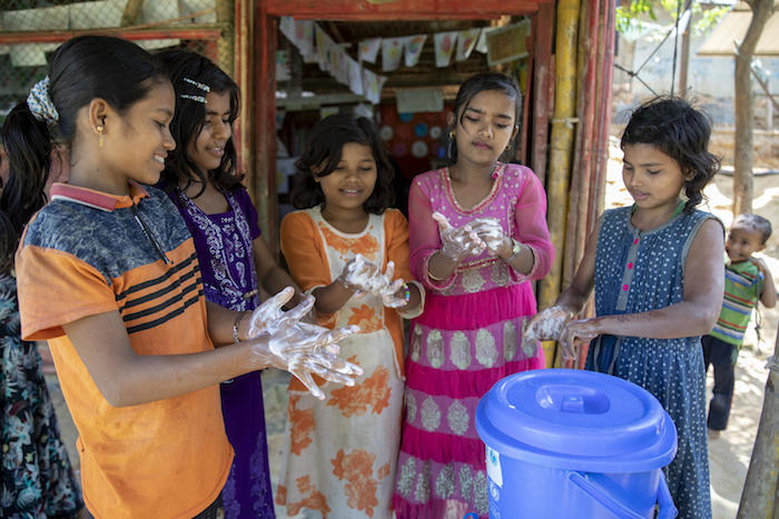 Rohingya refugee children wash their hands at a UNICEF-supported learning center in the Kutupalong camp in Cox's Bazar, Bangladesh.