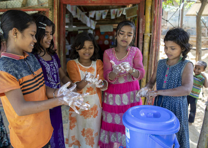 On March 9, 2020, children wash their hands with soap at a UNICEF-supported learning center in the Kutupalong camp, a Rohingya refugee camp, in Cox's Bazar, Bangladesh.