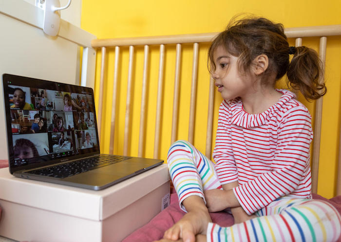 On March 30, 2020, Margot, 4, on a video call with friends from her daycare and their parents, at home in New York City.