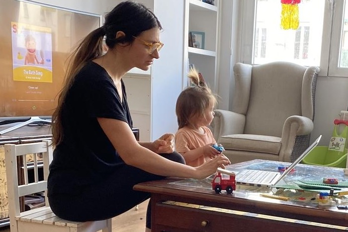 Ruben, 4, and his little sister play while their mother, Daniela, gets in a little work. Working from home makes it challenging for a parent to support their children's home learning experience. Routines are different, rules are different, and parents and