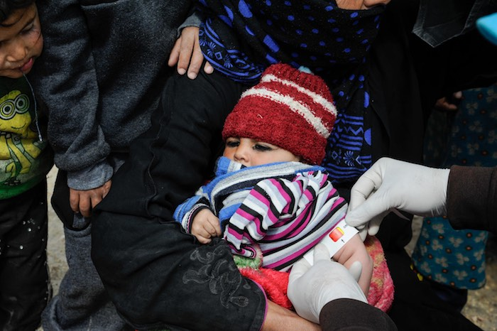 Children, like this toddler who's being screened for malnutrition, are the hidden victims of the coronavirus pandemic. Despite recent movement restrictions across Syria to prevent COVID-19 from spreading, UNICEF ensures that malnourished children at the M