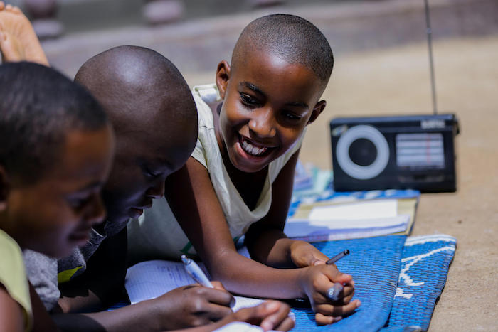 For children in Rwanda, remote learning means listening to lessons broadcast over the radio.