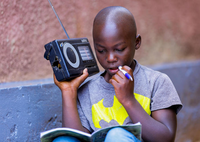 In Rwanda,11-year-old Kevin studies at home due to coronavirus-related school closures, listening to his Primary 5 lessons on the radio every day.
