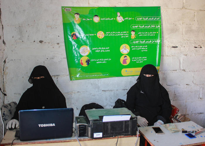On March 29, 2020, women work at a cash payment distribution site in Sa'ada, Yemen, serving Social Welfare Fund (SWF) beneficiaries.