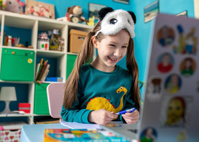 On 15 April 2020 in Kyiv, Ukraine, Zlata, 7, works on schoolwork from home, with all schools in the country closed as part of measures to combat the spread of COVID-19.