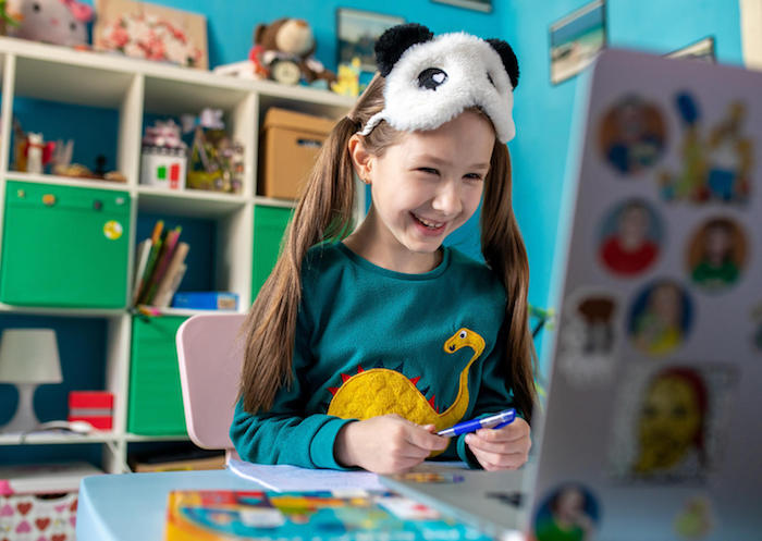 On April 15, 2020 in Kyiv, Ukraine, 7-year-old Zlata works on schoolwork from home while schools are closed to prevent the spread of COVID-19.