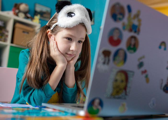On 15 April 2020 in Kyiv, Ukraine, Zlata, 7, works on a school assignment from home using on online learning platform developed by UNICEF,  Microsoft and the University of Cambridge.
