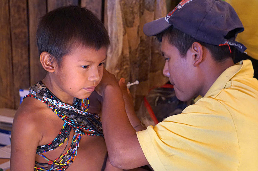 A UNICEF-supported nurse from the Hoti ethnic group vaccinates a child at the ambulatory health care center of the community of San José de Kayamá, Bolivar, Venezuela, on February 24, 2020.