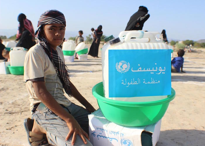 On April 27, 2020 in Abyan, Yemen, families displaced by insecurity collect UNICEF hygiene kits to protect them from the novel coronavirus.