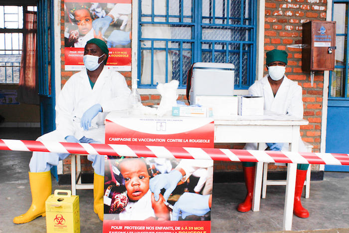 UNICEF-supported health workers masked and ready to administer measles vaccines in the Democratic Republic of Congo.