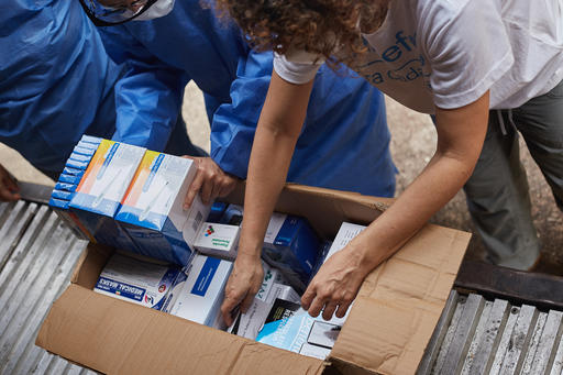 Monica Bucio, chief of UNICEF's Táchira field office in Venezuela, and health workers at a hospital in  Venezuela take stock of medical supplies delivered by UNICEF. Shop UNICEF Inspired Gifts.