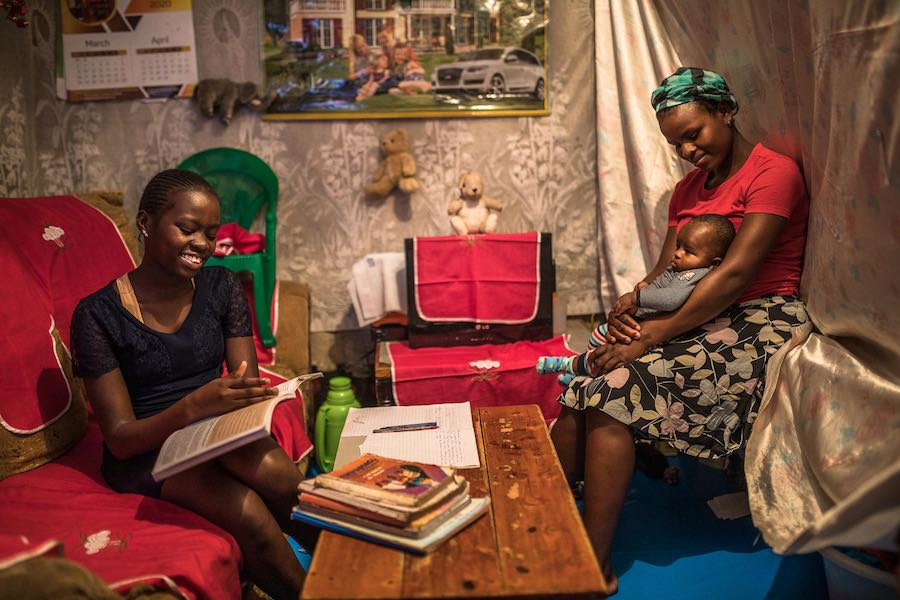 Sandra Achieng and her mom Winnie at their home in Kibera. The Kenya government gave directives that all school to be closed to curb the spread of the COVID-19 pandemic, Sandra always gets revision assignments from her classteacher via her father's smartp