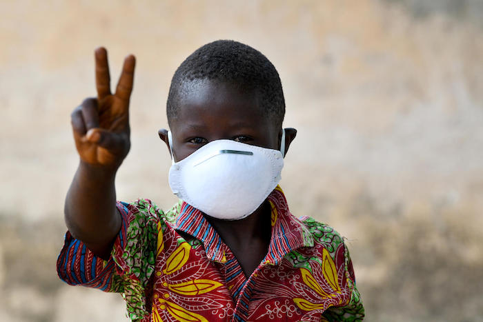 A young boy wearing a mask to protect himself against the coronavirus, in the village of Morovine, in the North of Côte d'Ivoire.