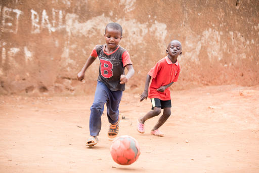 Jonathan, 5, plays soccer with his best friend, Shadrack. During Uganda's COVID-19 lockdowns, schools close, leaving the country's kids at loose ends. But throughout the pandemic, playing sports has helped children like Jonathan and Shadrack stay active.