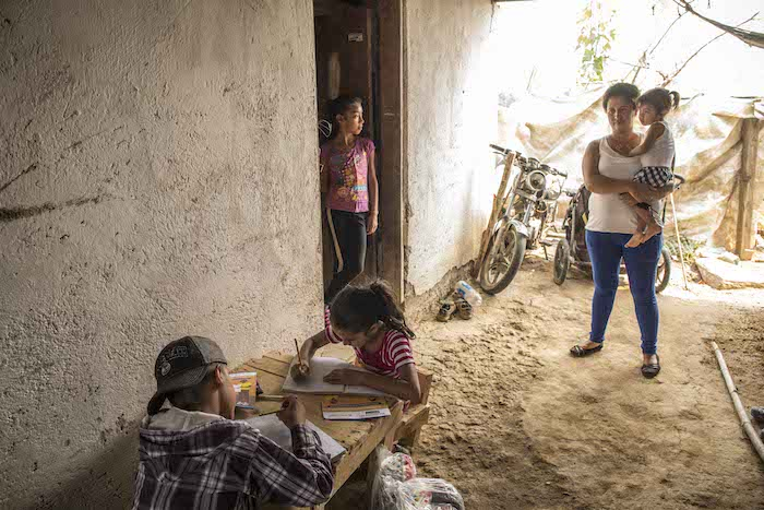 A mother and children at home in Guatemala where UNICEF is working with the government to support remote learning during the COVID-19 pandemic.