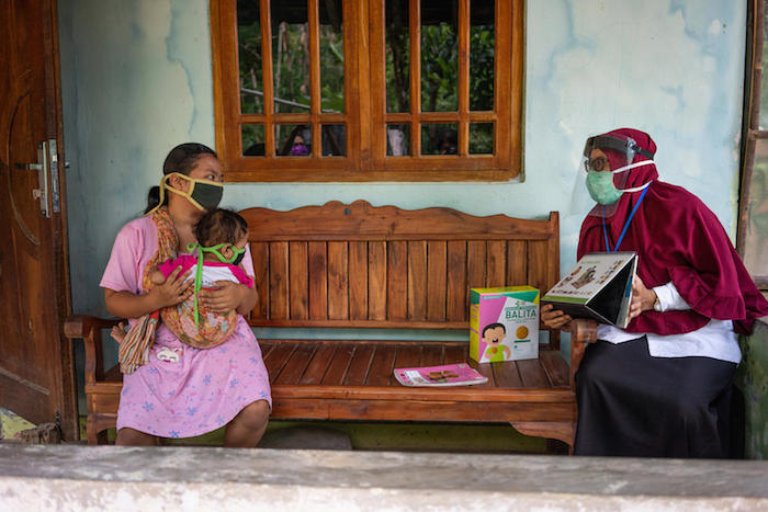 A nutritionist counsels the mother of a 2-year-old girl during a home visit in Paseban Village in Klaten, Central Java, Indonesia.