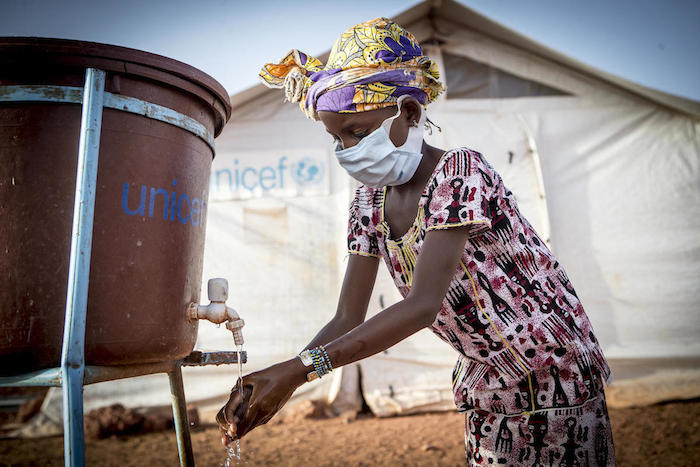 Hamsatou, 13, washes her hands at a camp for displaced families in Mopti, Mali, where UNICEF is helping to improve health and hygiene and communicate best practices for COVID-19 prevention.