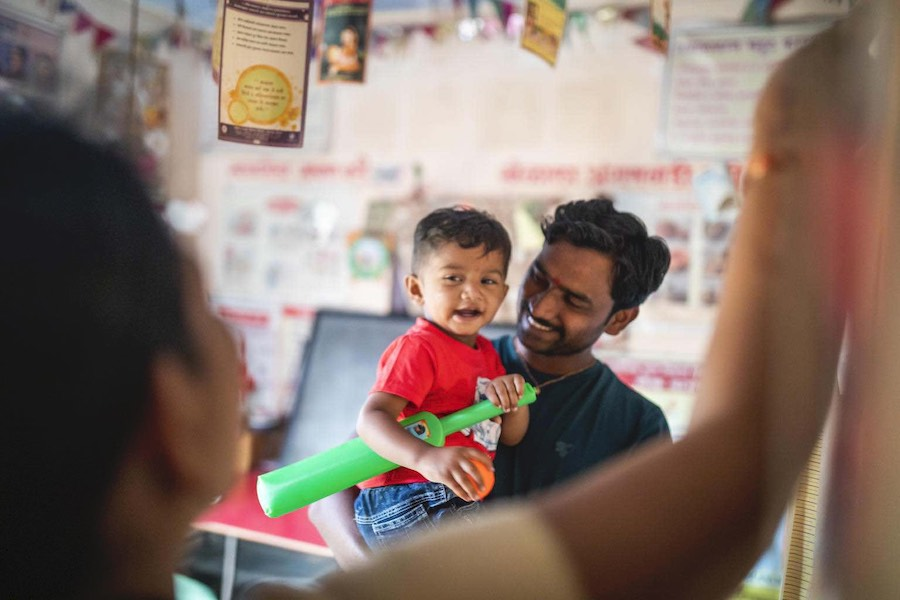 Chetan Mhaske takes care of his child, Ryan, at one of India's Anganwadi centers.