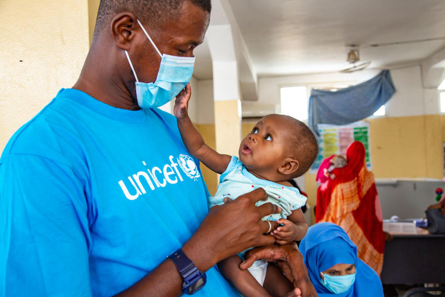 A UNICEF nutrition specialist holds a baby being treated for malnutrition at the UNICEF-supported Dar Naim nutrition rehabilitation center in Nouakchott, Mauritania.