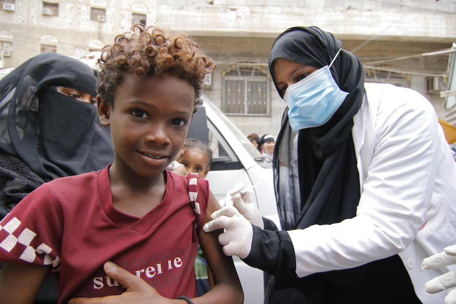 Mohammed, 13, is vaccinated against diphtheria at Khawr Meksar clinic in Aden, Yemen, as vaccinations continue despite the COVID-19 pandemic.