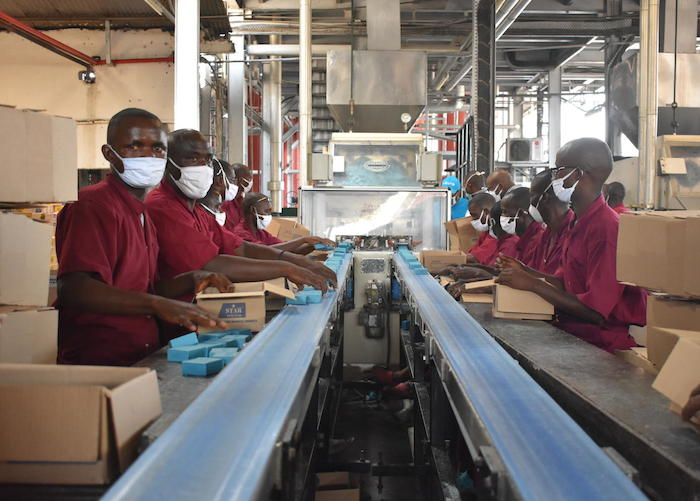 Workers at the Savonor factory in Bujumbura, Burundi, making soap that will be sold at half price to promote handwashing and limit the spread of COVID-19.