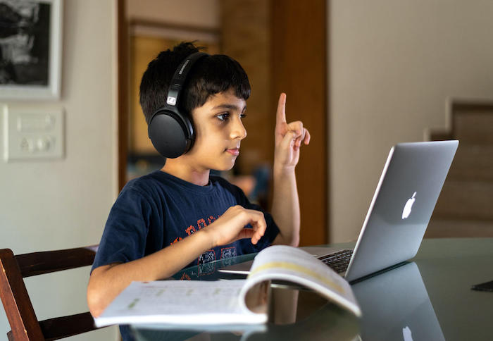 Veer, 10, attends online school during COVID-19 lockdown from his home in India.