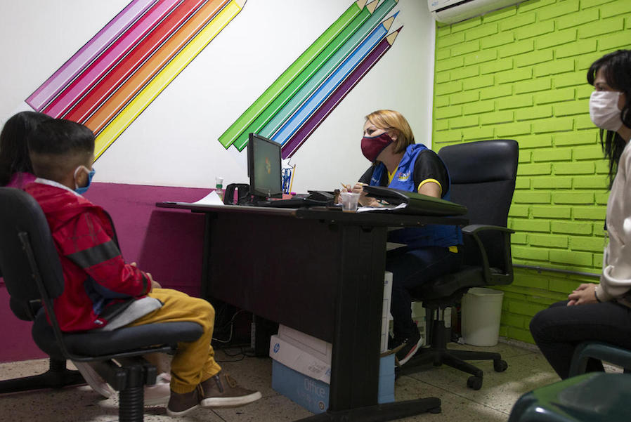 UNICEF-supported child protection counselors Nancy (center) and María José met with two young children to provide counseling after their caregivers requested support for family conflict resolution in Venezuela's Táchira state, on July 22, 2020.
