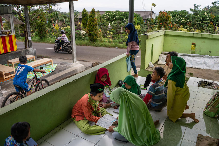 yaiful, 12, a child with a physical impairment, studies the Quran with his classmates at a UNICEF-supported school in Banyumas, Central Java, Indonesia in 2020.