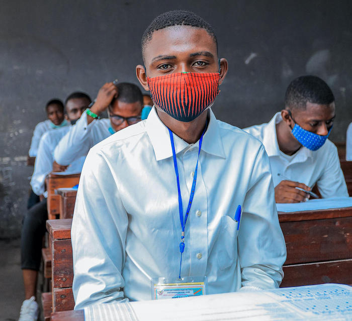 Justin, in his final year of secondary school in Kinshasa, DR Congo, sits for an exam.