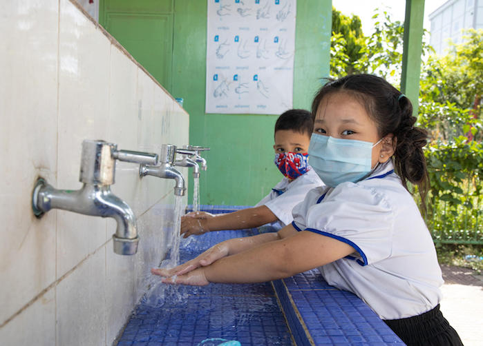Students washing their hands during a break at Preah Norodom Primary School, Phnom Penh, Cambodia.