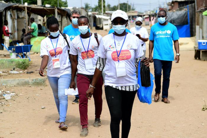 A team of polio vaccinators make the rounds in Gonzagueville, a suburb of Abidjan, Côte d'Ivoire.