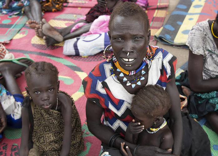 Four-year-old Katalin, left, with her mother, Maze, and baby sister Kaka at a UNICEF-supported nutrition center in Pibor, South Sudan in September 2020.