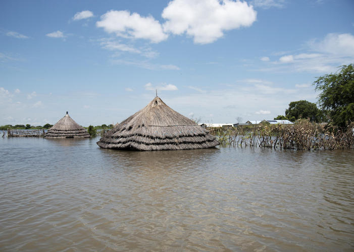 In September 2020, floodwaters in Pibor, South Sudan have swallowed up houses, leaving only their rooftops visible.