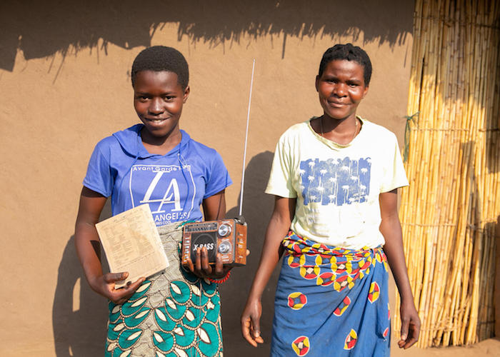 Sixteen-year-old Amina, above left with her aunt, Zainubu White, is continuing her education with UNICEF-supported lessons broadcast on the radio in Malawi.