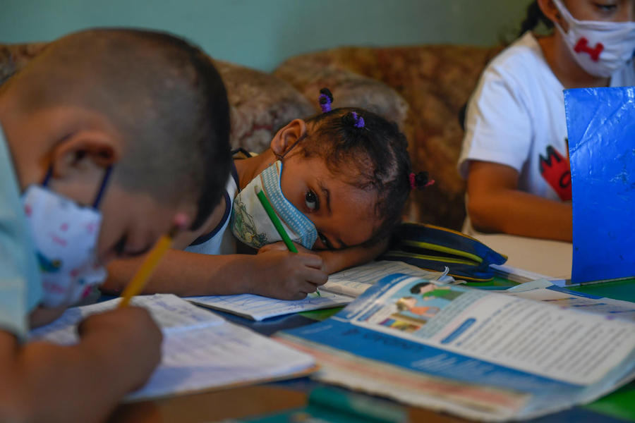 Children attend class in an improvised classroom in a house in the Petare neighborhood, Venezuela's largest slum, in Caracas, amid the COVID-19 pandemic.