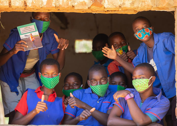 Students seen through a classroom window at Luwambaza primary school in Malawi on September 24, 2020.