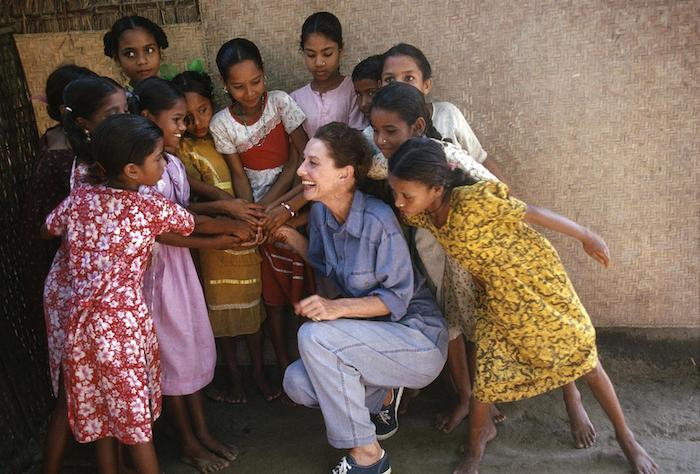 UNICEF Goodwill Ambassador Audrey Hepburn laughs with girls during a visit to Bangladesh in 1989.