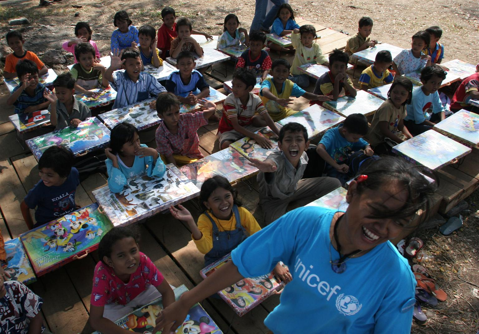 A UNICEF program coordinator runs a class at a displacement camp in Banda Aceh, Indonesia, helping children work through trauma through activities. ©UNICEF/NYHQ2005-0323/ESTEY