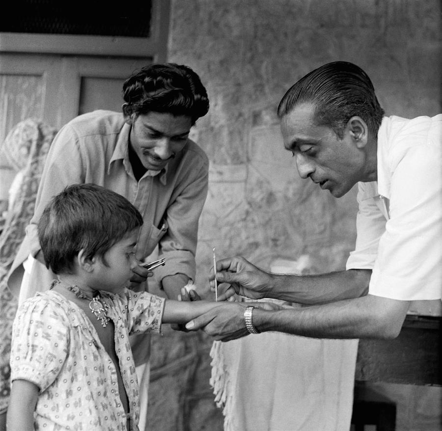 A girl is vaccinated against smallpox in India by a UNICEF-supported health worker circa 1961.