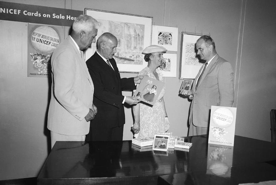 UNICEF Executive Director Maurice Pate and Prime Minister of Australia Robert Menzies, Mrs. Menzies and E.J.R. (Dick) Heyward review the 1958 selection of UNICEF greeting cards.