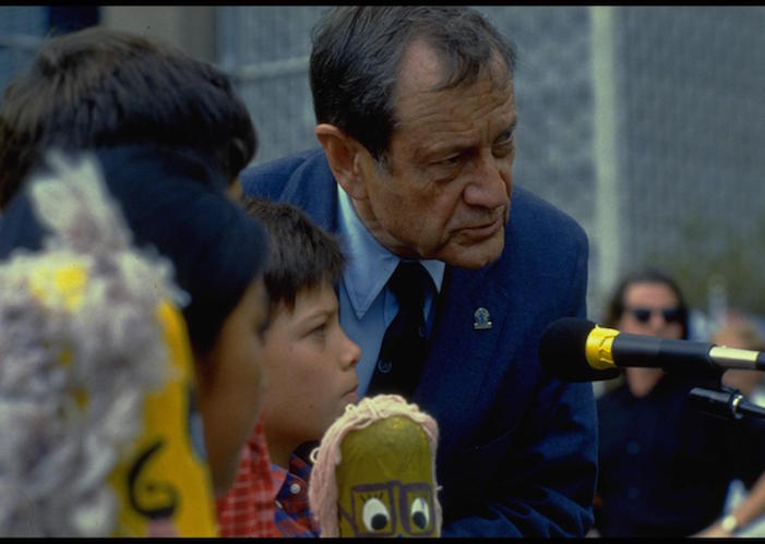 UNICEF Executive Director James Grant, together with children representing several countries, addresses the Outdoor Forum, held on the North Lawn at United Nations Headquarters on September 26, 1990 in celebration of the World Summit for Children.