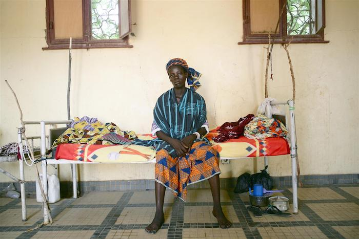 In Mali, a woman recovers in a hospital after suffering a ruptured uterus that resulted in the stillbirth of her baby.