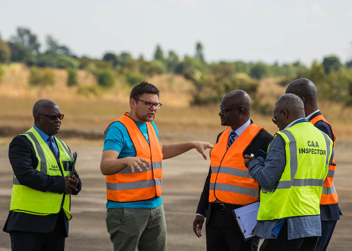 Tautvydas Juskauskas, UNICEF Malawi's Drone Specialist, with civil aviation officials in Malawi in 2019.