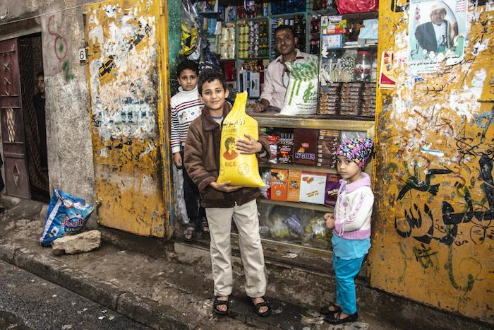 A boy in Sana'a, Yemen, is able to buy food thanks to support his family received from a UNICEF emergency cash transfer program.