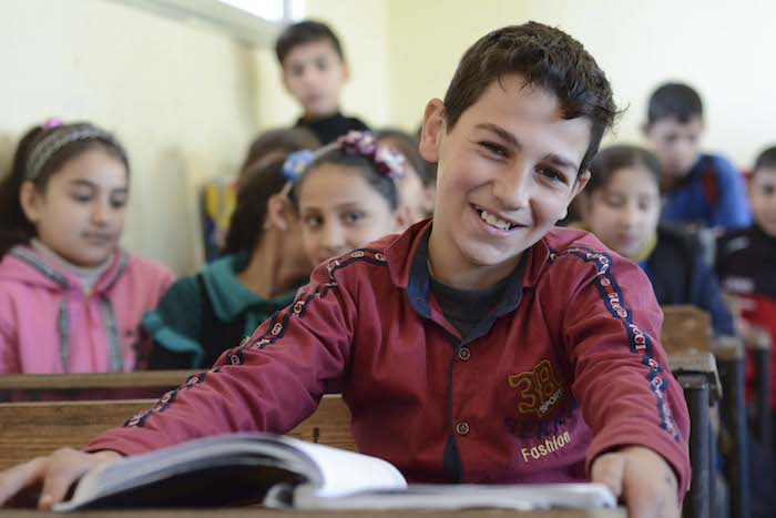 "Yousef, 10, got back to learning in a ""real"" school in 2018 thanks to efforts by UNICEF and partner Educate A Child to rehabilitate damaged classrooms and reopen five schools in Homs."