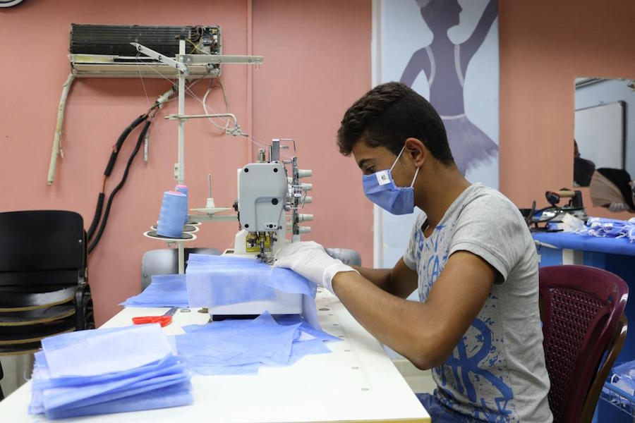 Majd, 17, is a trainee in a sewing course at the UNICEF-supported youth center in Jaramana, rural Damascus, Syria.
