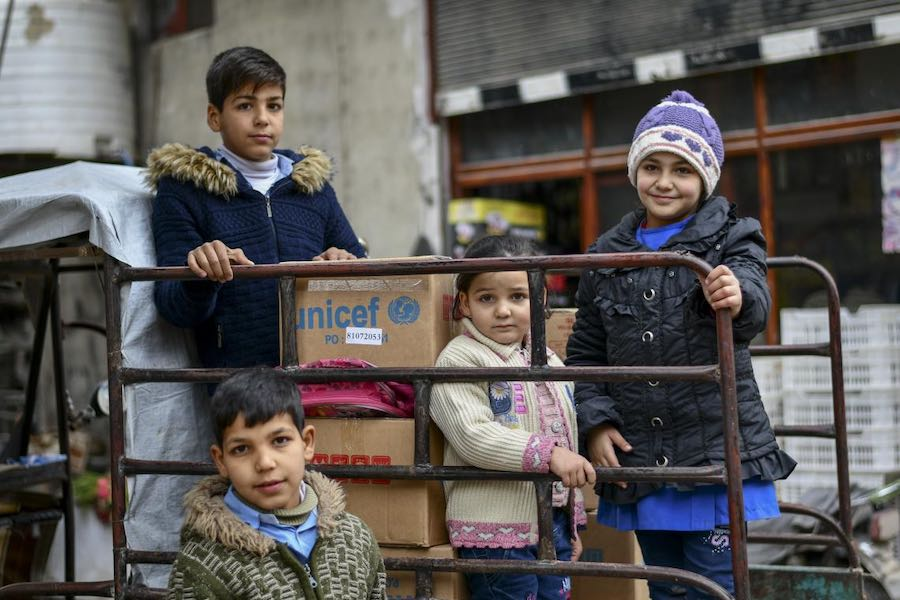 "Siblings Firas ,12, Mohammad ,11, Batoul ,8, and Fatima, 3, all received new winter clothing kits, distributed by UNICEF in Hamourieh, rural Damascus, thanks to a generous contribution from Canada and DFID. ""Since I lost my husband four years ago, life ha"