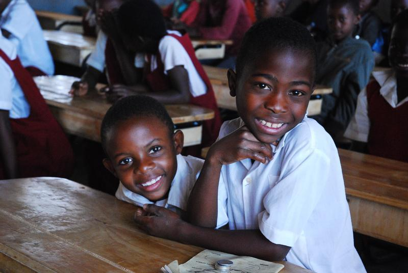 Students in Malawi benefit from desks provided by the K.I.N.D. fund.