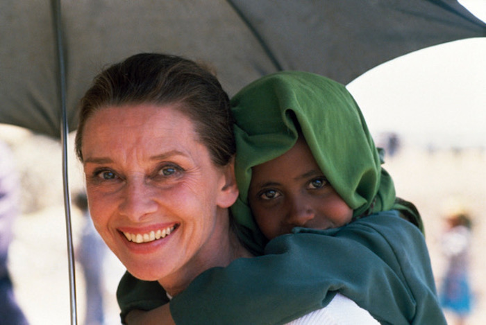 UNICEF Goodwill Ambassador Audrey Hepburn shares her umbrella with an Ethiopian child during one of her many field visits.