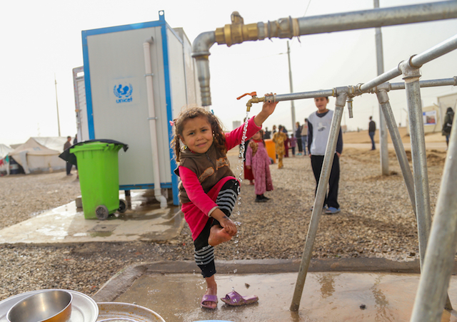Four-year-old Athra was forced from her home in Mosul by escalating, violent conflict. Now she lives at the Debaga Camp in Erbil Governorate, Iraq, where she can wash at a UNICEF water tap.